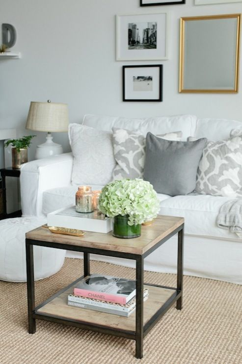 For my mom cave! Living Room with a white couch, grey pillows and wood coffee table. Simple and clean. Maybe add a pop of color with a bright pillow