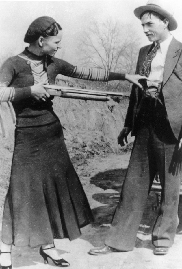 This this undated file photo shows outlaws and lovers Bonnie Parker, left, and Clyde Barrow. Guns and other items connected to the couple are going on auction by RR Auction of Amherst, N.H.
