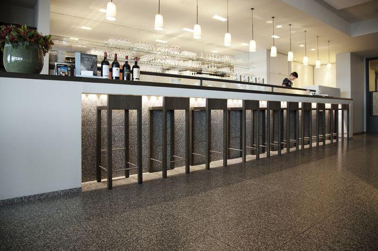 Bar featuring beautiful black terrazzo available at Signorino Tile Gallery  #terrazzo  #naturalstone #quartz #interiordesign #architecture