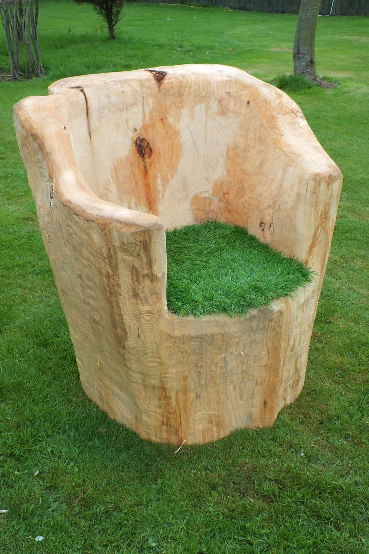 Outdoor log chair, with artificial grass seat pad. Click for more info