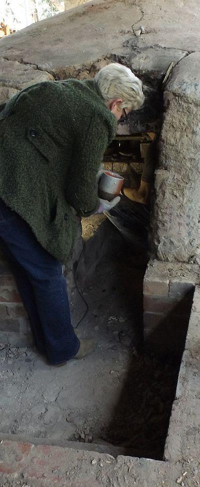 Pot emerging from the Olsen groundhog kiln, Strathnairn Arts, 18 September 2014.