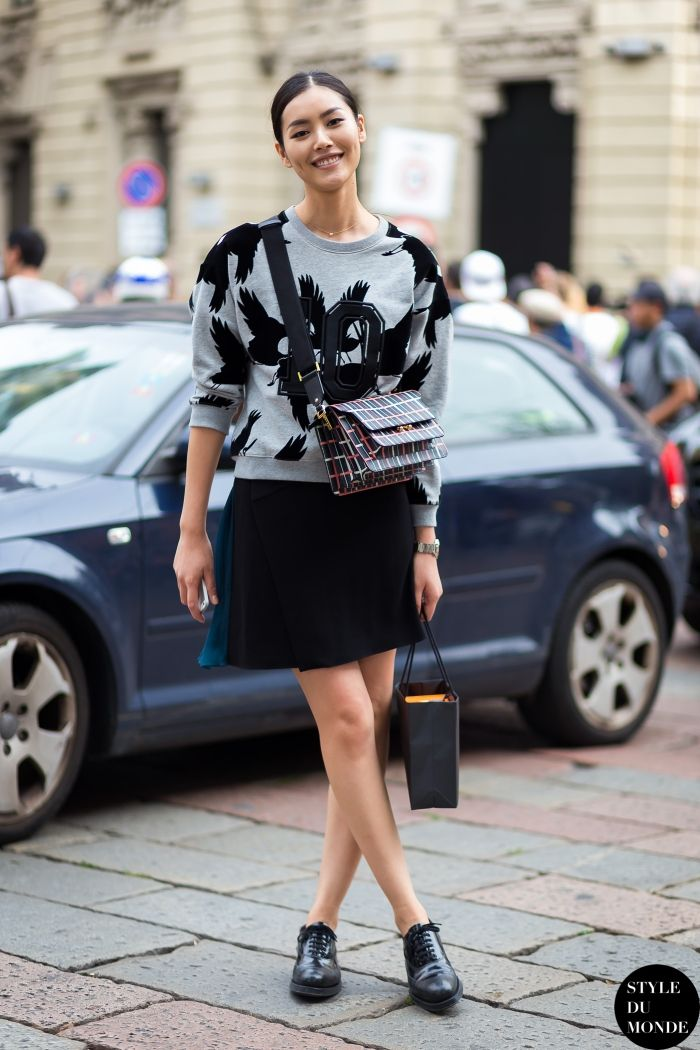 Opt for comfort in a grey print crew-neck sweater and a black mini skirt.  Shop this look for $1,495:  http://lookastic.com/women/looks/black-leather-crossbody-bag-and-grey-print-crew-neck-sweater-and-black-mini-skirt/3970  — Black Plaid Leather Crossbody Bag  — Grey Print Crew-neck Sweater  — Black Mini Skirt