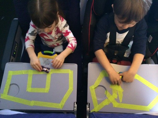 """cute idea for plane rides: bring painters tape and """"draw"""" a road/airport/whatever for kids to use toy cars/planes on (painters tape won't leave residue on the tray table like duct tape would)."""