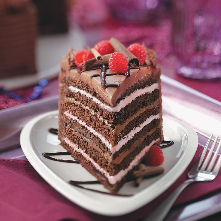 Best Chocolate Raspberry Torte Recipe -How do you make already delicious chocolate cake even more decadent? By adding a heavenly raspberry filling and a lovely chocolate drizzle. —Taste of Home Test Kitchen