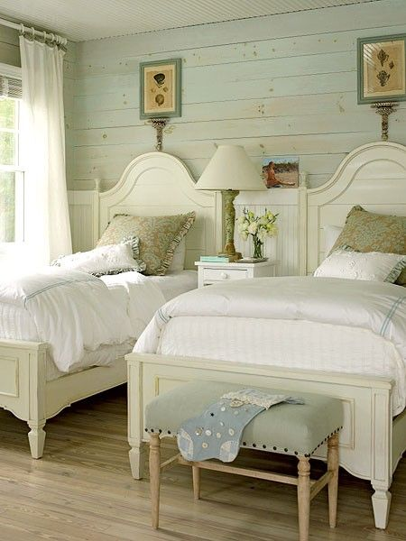 My most pinned pin:  aqua tinted shiplap horizontally on the walls, painted twin beds with creamy linens, upholstered bench at the foot of the bed with nailhead accents, beach cottage coastal style