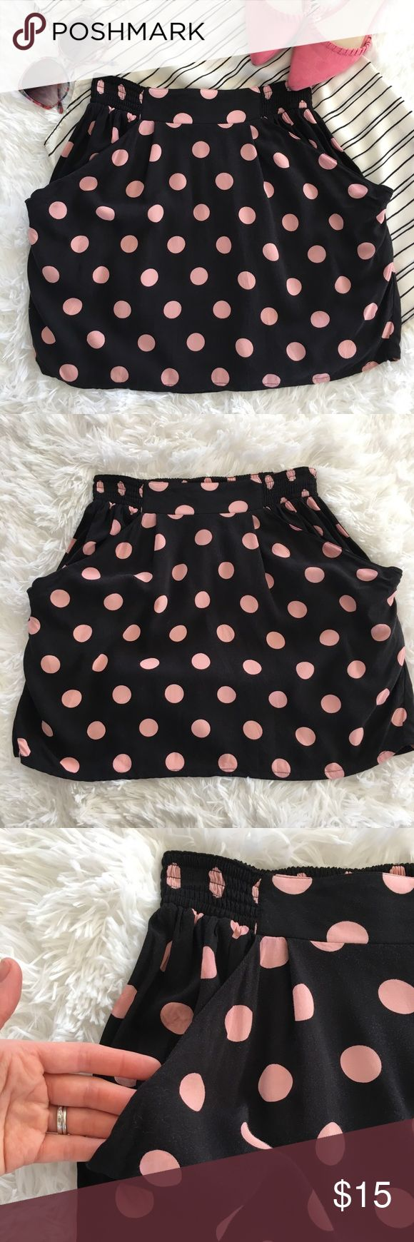 "H&M Divided skirt with pockets This black H&M Divided skirt features pink polka dots, wide elastic waistband, and pockets. It's super comfy and easy to wear, in excellent used condition.   Feel free to ask me any questions, make an offer, or bundle for greater discount! 😘   Width: 12.5"" Length: 15.5"" H&M Skirts Mini"