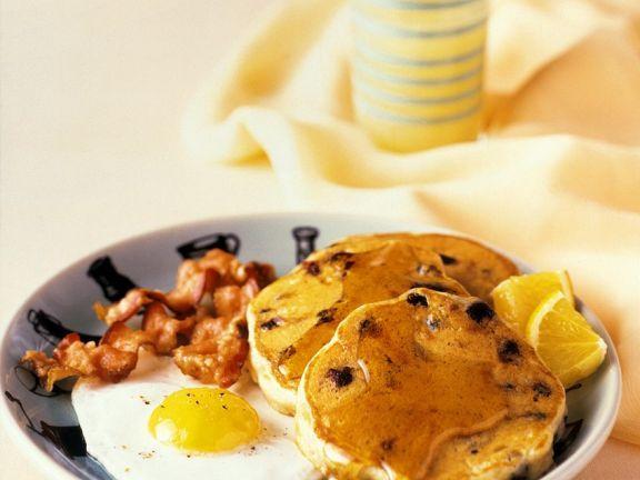 Amerikanische Pfannkuchen mit Spiegelei, Bacon und Sirup ist ein Rezept mit frischen Zutaten aus der Kategorie Pfannkuchen. Probieren Sie dieses und weitere Rezepte von EAT SMARTER!