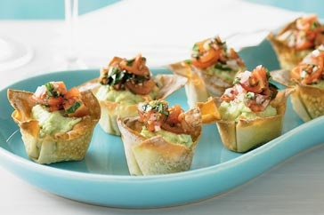 A topping of tangy tomato salsa brings out the best in these bite-sized wonton baskets - perfect for a New Year's Eve party!