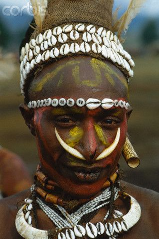 Papua New Guinea | An Iwan warrior wears his native dress, including a bone through his nose, a reminder that his tribe were once cannibals. | Image and caption © Charles & Josette Lenars