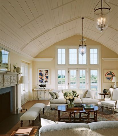 A gambrel style roof adds character to the exterior of a home, but also opens possibilities for unique interior spaces, like this great room. Perhaps a better function for this space might be as a detached 'great room' based on a 'recovered gambrel stable' design that opens on all sections where the stable bays might have been?