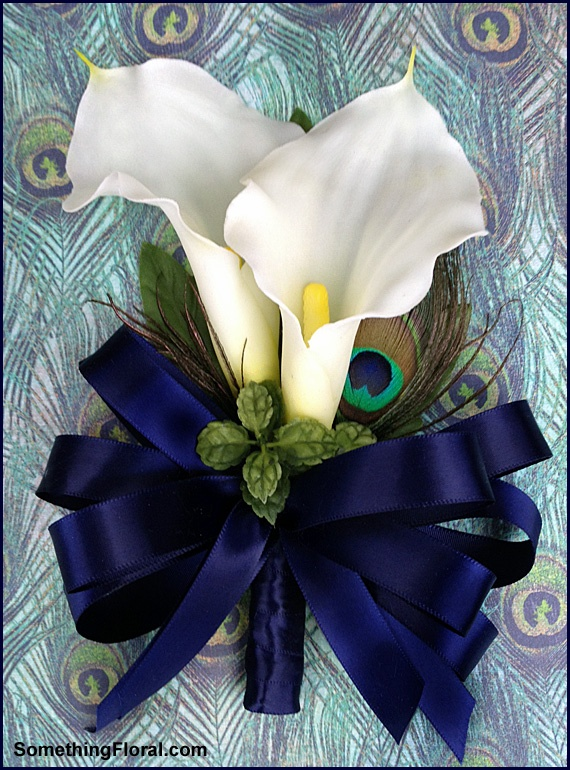 Realistic, artificial, white double calla lily and peacock feather mother's pin-on style corsage with navy satin bow and stem wrap by Something Floral / Something Spectacular, Warren, MI. Available for custom order by contacting florist website or Etsy shop: http://www.etsy.com/shop/SomethingFloral. Photo: Urban Fire Studio. #wedding #flower #corsage #wear #peacock #feather