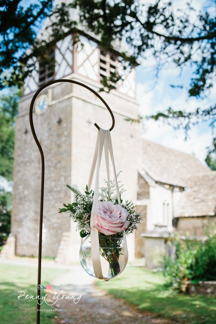 Wedding flowers at the church. Summer wedding at The Rectory Hotel in Crudwell, Wiltshire. Photography by Penny Young Photography.