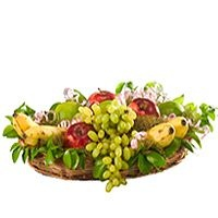 Fruity Gourmet – A delicious fruity gourmet consisting of   a) apples,  b) grapes,  c) bananas,  d) sweet limes etc. (5kg) decorated in a carved bamboo basket.