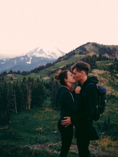 mountain top kisses for two adventurers.