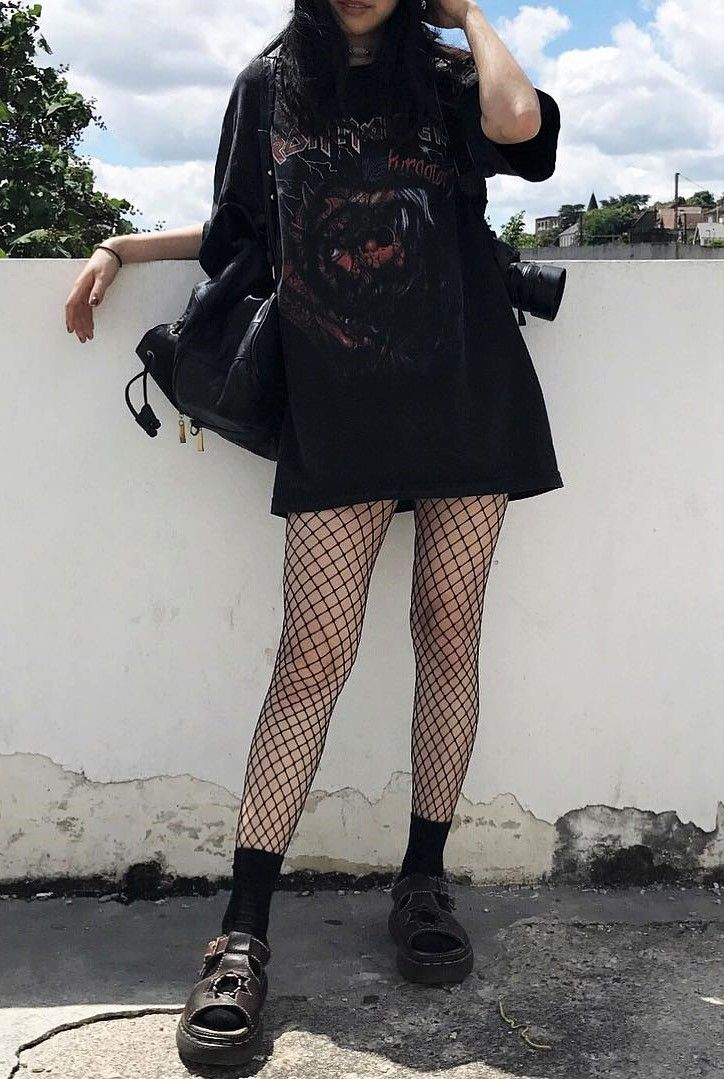 Oversized black graphic tee with fishnet leggings & Dr Martens shoes by everlastingpure - #fashion #grunge #alternative