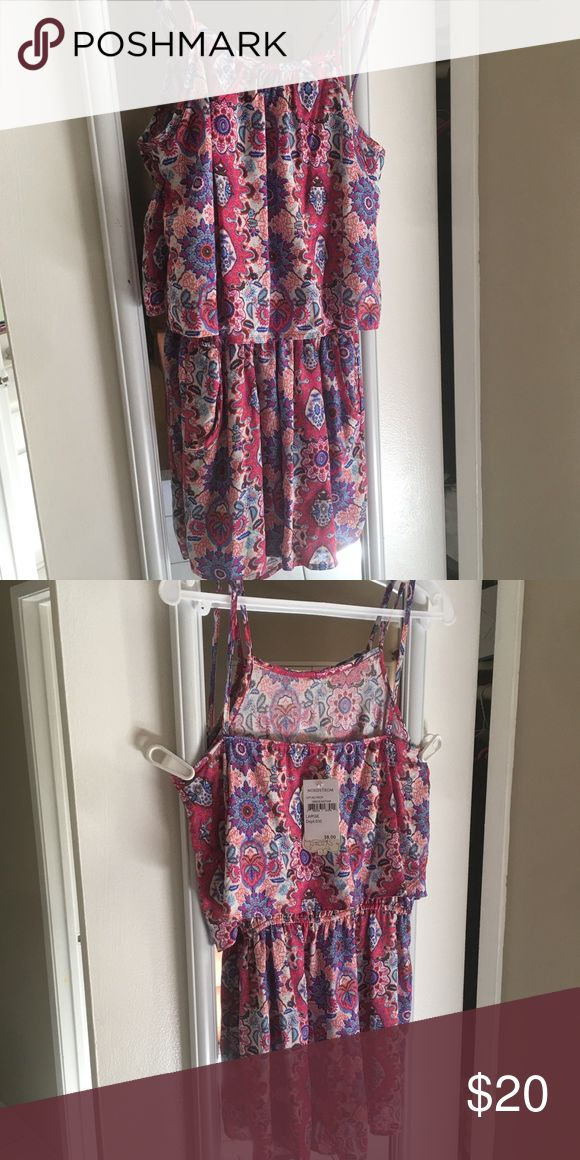 NWT junior romper Brand new romper • Sz. Large • scratchy waist band • pretty, flowy, and fresh • perfect for spring and summer Soprano Bottoms Jumpsuits & Rompers