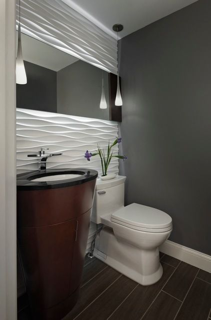 Powder room with a gorgeous accent wall. An excellent installation idea for our Satin Bianco Wave...x