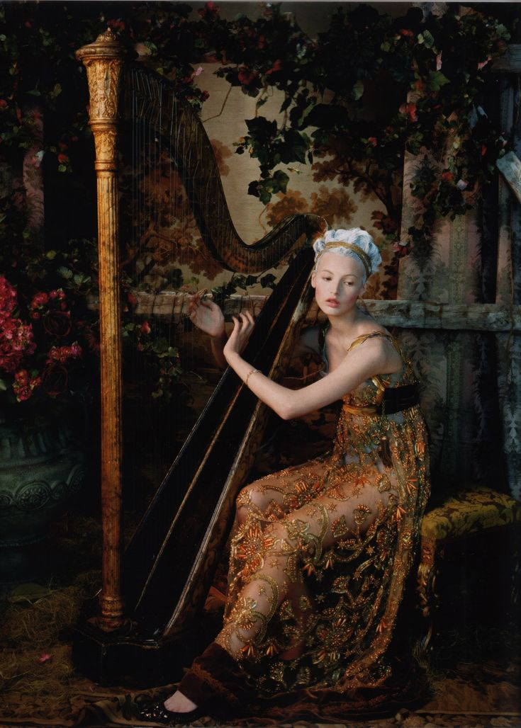 Ritrato de una Dama (Portrait of a Lady). Mona Johannesson playing the harp as Maria Antonieta. Juan Gatti for Vogue España, October 2006. Beautiful transparent dress with a delicate gold pattern and velvet trimming.