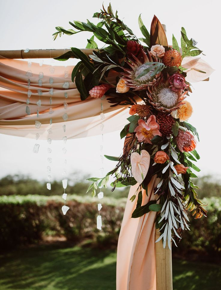 Maui Wedding  Just make winter themed w/ pine, pine cones, berries, a rose and maybe something else winter-y.