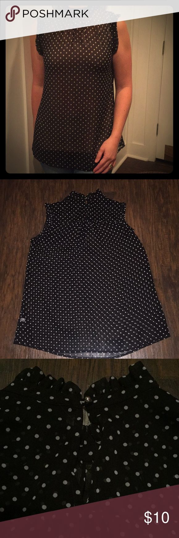 WHO WHAT WEAR BLOUSE Sheer black with white polka dots, sleeveless with ruffle trim around the neck/arm holes.  Tunic length. Keyhole button in the back. I'm wearing a nude cami underneath (not included) WHO WHAT WEAR Tops Blouses