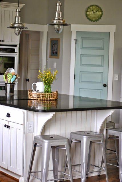 I lovethe wood island, bar stools, robin egg blue door, pendent lighting