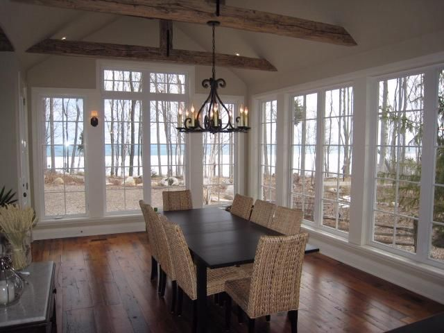 Beautiful windows that surround the room. Visit vanguardhomedesigns.com for more information!