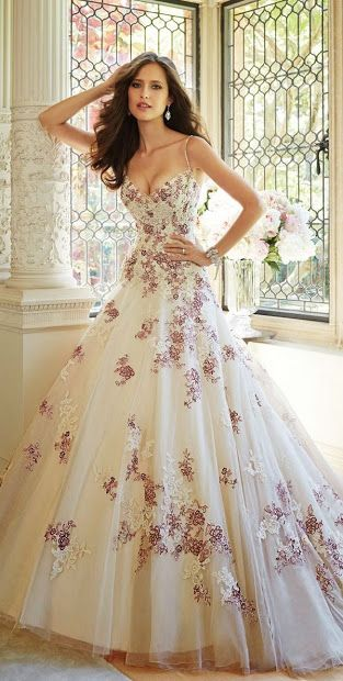 Possible bridal gown. Love the floral detailing but I'd show less cleavage and wear my hair up.