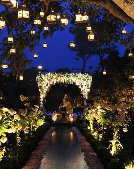 enchanted garden night wedding with hanging lanterns