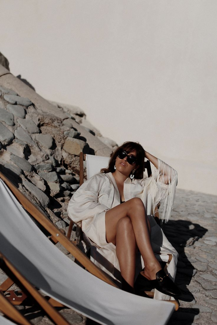 Fiona Dinkelbach from thedashingrider.com wears a & OTHER STORIES x TOMS nude silk kimono coverup, black GUCCI Princetown slipper, CÉLINE caty sunglasses in Havana, a black ZARA swimsuit and the LOEWE Joyce bag in tan | Style Blogger | Location: Saint-Raphael, South France - Cote D'Azur | The Dashing Rider | The look is also available here: http://liketk.it/2s2N4