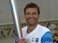 Ryan Seacrest carried the Olympic flame during the Athens 2004 Olympic Torch