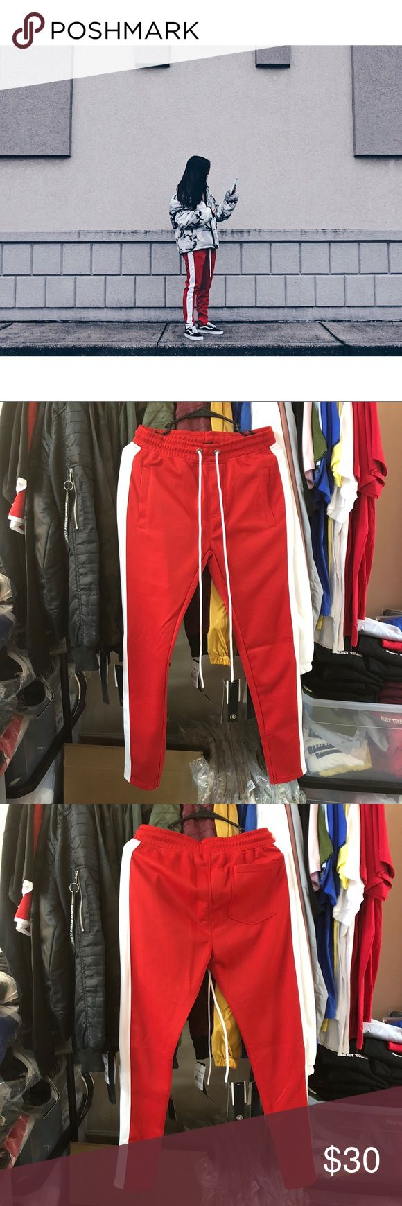 "Track Pants - Red/White Bleecker & Mercer 95% Polyester 5% Spandex   Zipper at the Ankles Model 5'4 1/2"" 120 lbs wearing a size small True to Size Size Up For a Looser Fit Manufacturer's Suggested Retail Price: $69.99 Pants Sweatpants & Joggers"