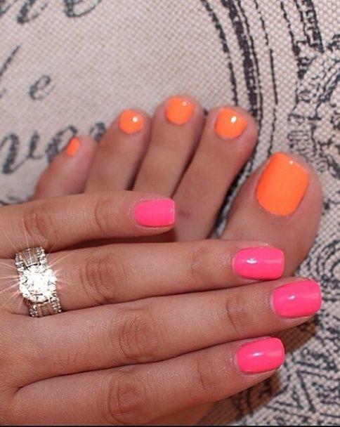 <3 orange toe nails and pink finger nails