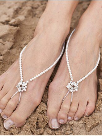 Delicate pearl barefoot sandals with a single diamante detail & beaded toe loop perfect for beach weddings. These sandals are elasticated so that one size fits all.