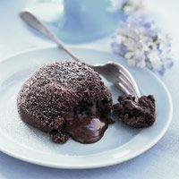 Molten Chocolate Cakes Recipe - Delish.com  Can make ahead & freeze then bake!