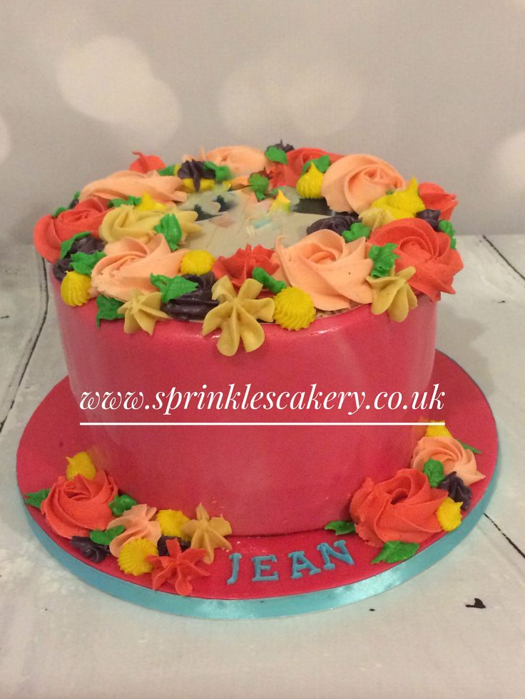 Although this fondant covered chocolate cake is heavily decorated with piped buttercream flowers, it was also topped with an edible image of the birthday girl printed in-house onto icing paper. More info on edible printing products can be found on our website or Facebook page.