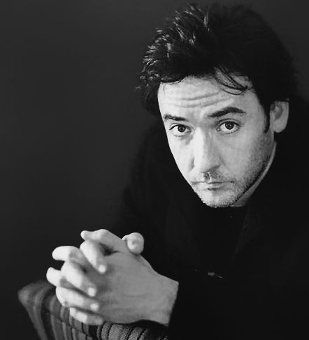 John Cusack~ so handsome. has an elegance about him but with a bad boy edge. also wonderful charm and love his voice and his laugh.