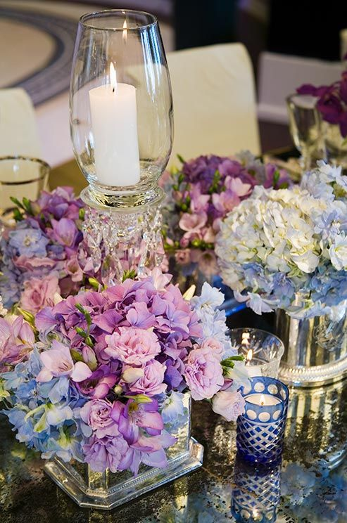A Mix Of Various Blooms In Shades Purple Blue And White Are Mixed For Table CenterpiecesPurple CenterpieceWedding CenterpiecesBirthday
