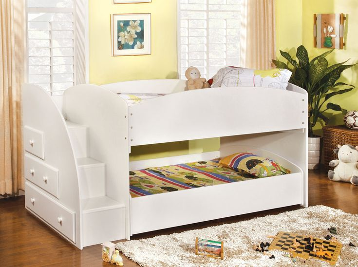 $630 plus ? shipping. This is my fav style: The bunk bed is much lower to the ground. The child on top doesn't need to climb on to the mattress below to get down each morning, and when the trundle is pulled out, the child beneath can get more head space and not be allowed to kick the underneath of the bunk bed above.