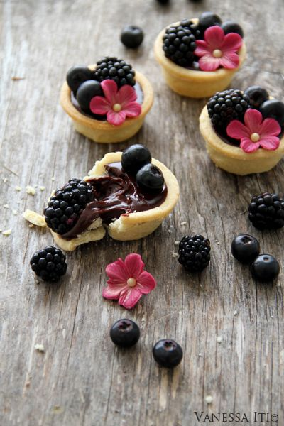My simple ganache:    Makes approx 25 small chocolate tarts.    Ingredients:    220g Good quality dark chocolate {I use callebaut dark chocolate}  20g Castor sugar  200mls Pouring cream  50g butter {cut into small cubes}