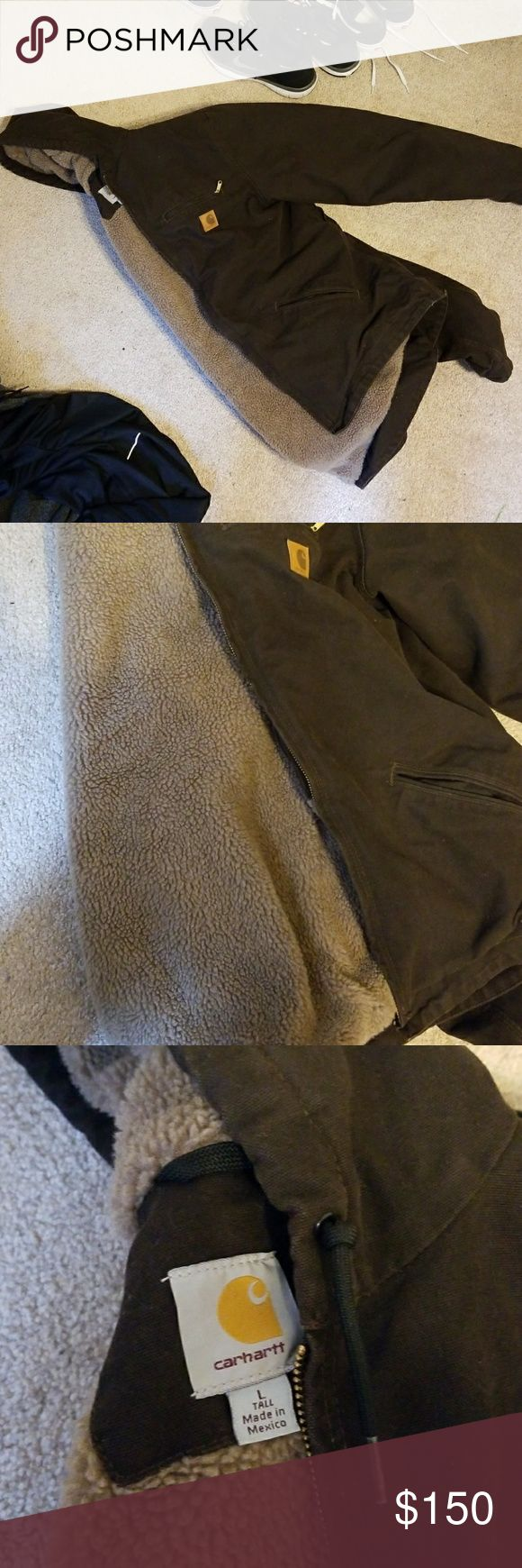 Carhartt winter jacket Great condition, rarely worn.  Has a hood.  Extremely warm fabric on inside of jacket.  Quality can be felt. Carhartt Jackets & Coats