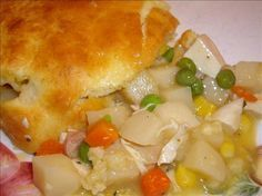 Easy Bisquick Chicken Pot Pie - in the oven. I'll let you know how it is. I made 2 substitutions: I used 1-1/3 c. sliced raw carrots (threw them in the water with the chicken) and 1/3 frozen lima beans. It's what I had. May be different next time. The other substitution: I use a dry mix now that I made and keep around to use in place of canned soups. Also added some poultry seasoning.