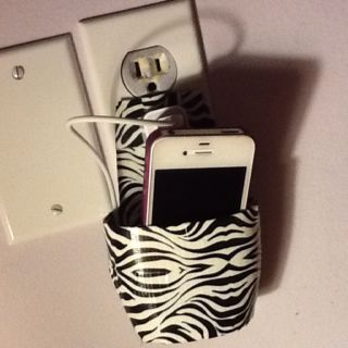 Made my own cell phone holder out of a lotion bottle and used ducktape to cover it :) no more phone sitting on the ground