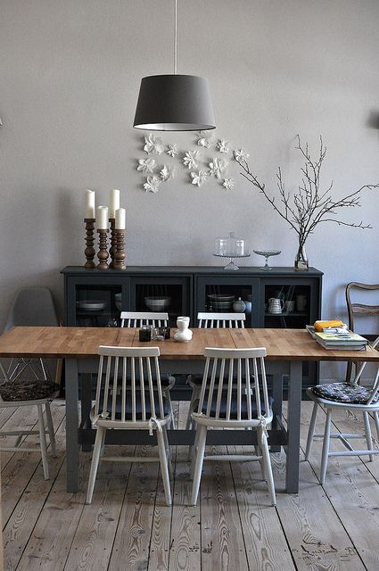 change up the chairs with white eames and paint the legs of the table black.