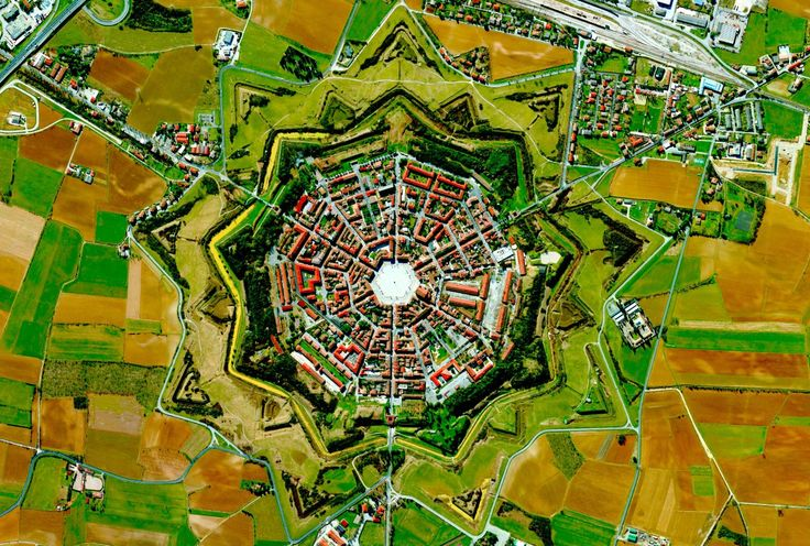 Location | Palmanova, Udine Province, Italy Palmanova is a city built in 1593 during the late Renaissance period. It is one of the many old star forts from this period. This 9 pointed star fort, de…