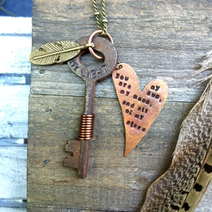 Hand stamped • iron skeleton key necklace keepsake • my light • metal feather & wire wrapped • stamped tag by FeathersandBrass on Etsy