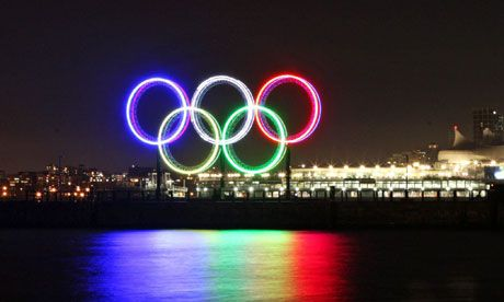 Olympic rings over water.