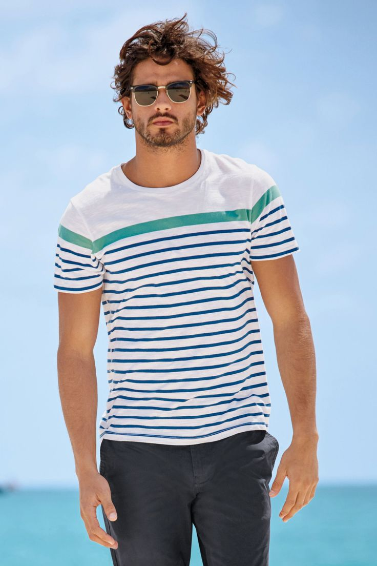 Marlon Teixeira is back in the spotlight as he hits the beach for Next. The Brazilian model showcases casual summer styles as he soaks in the sun. From tre