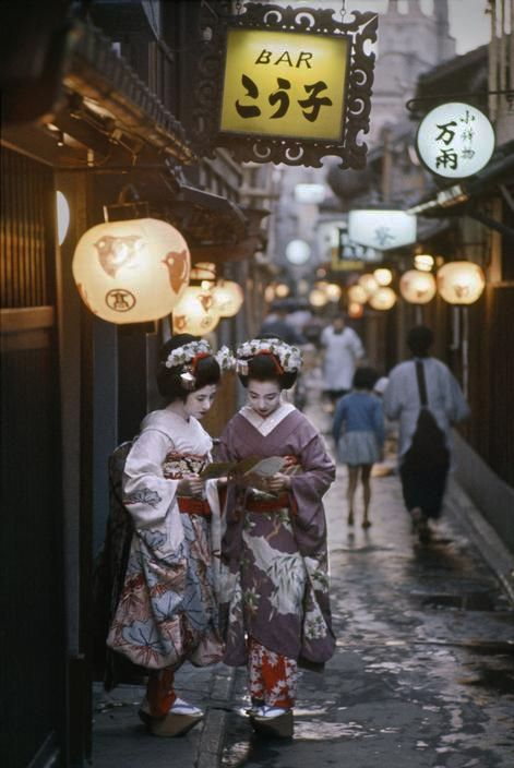 Two Maiko on their way to evening appointments in Kyoto, Japan - 1961