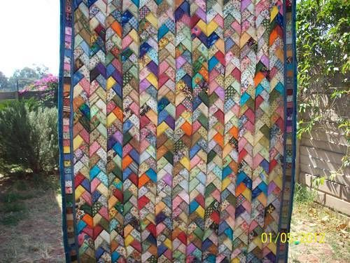 This is really pretty  Scrappy Pioneer Braid quilt - QUILTING