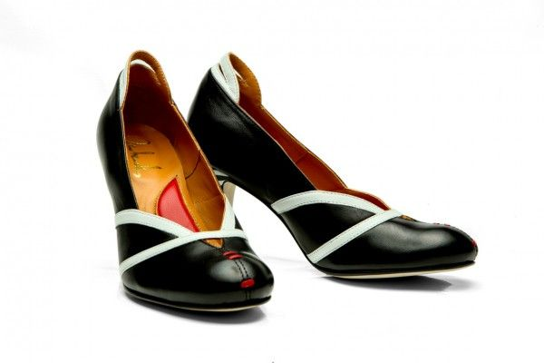 Full leather upper, lining and sole  Black and white goat skin Signature red leather stitching Covered heel measures approximately 85 mm/ 3.3 Inches  Low V cut vamp Rounded toe Slip on Size: 36, 37, 38, 39, 40, 41 EU size